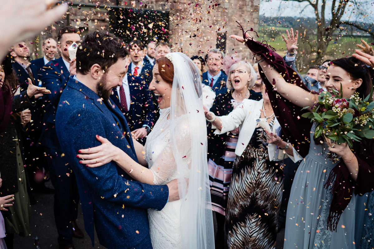 Bride and Groom confetti shot at The Ashes Barns - Winter Wedding Ideas